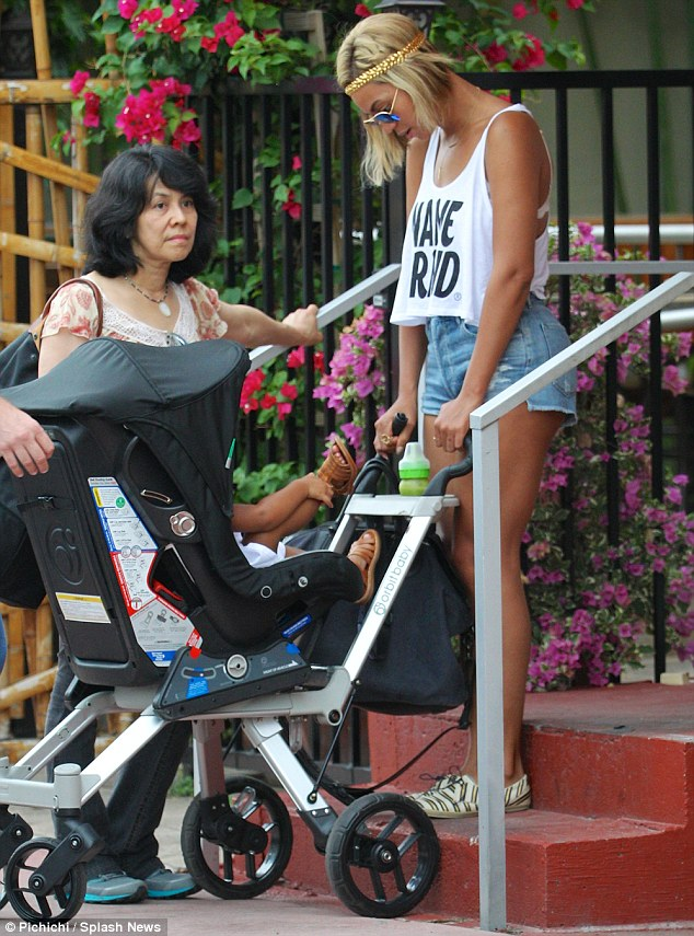 Hands-on mom: The Crazy In Love singer didn't need any help pushing the pram down the concrete steps
