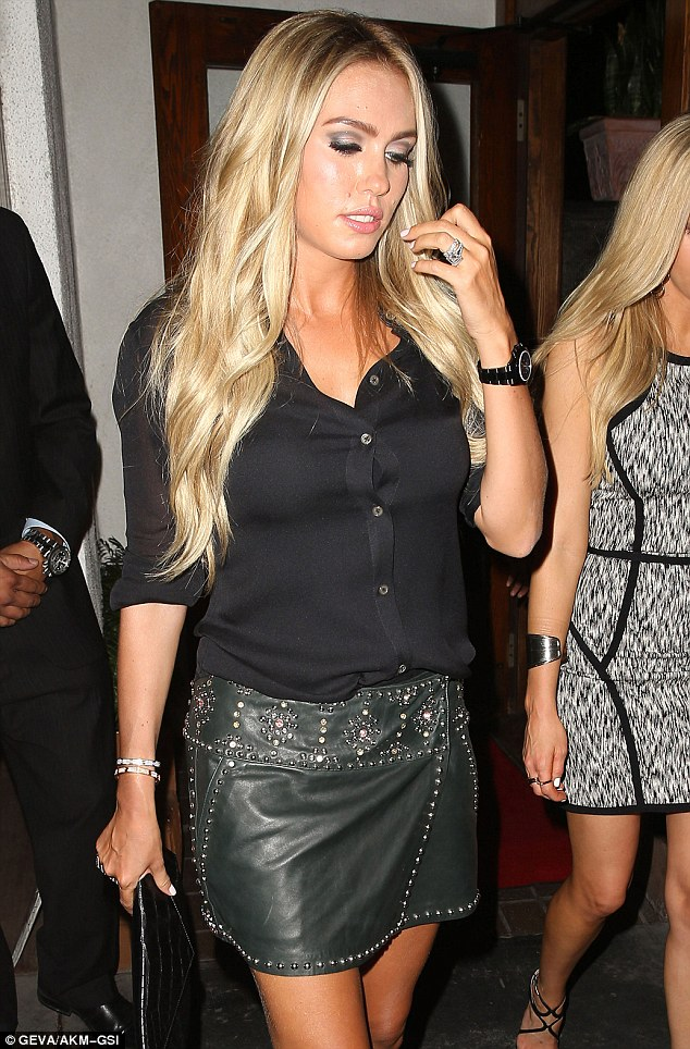 Dressed up: Heiress Petra looked chic in her leather mini skirt which featured stud detailing