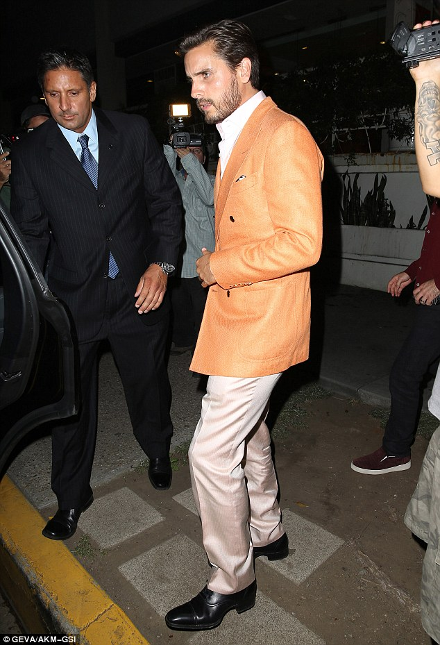 Celebrating: Scott Disick stands out in an orange blazer as he heads for dinner with Petra Ecclestone and her husband James Stunt