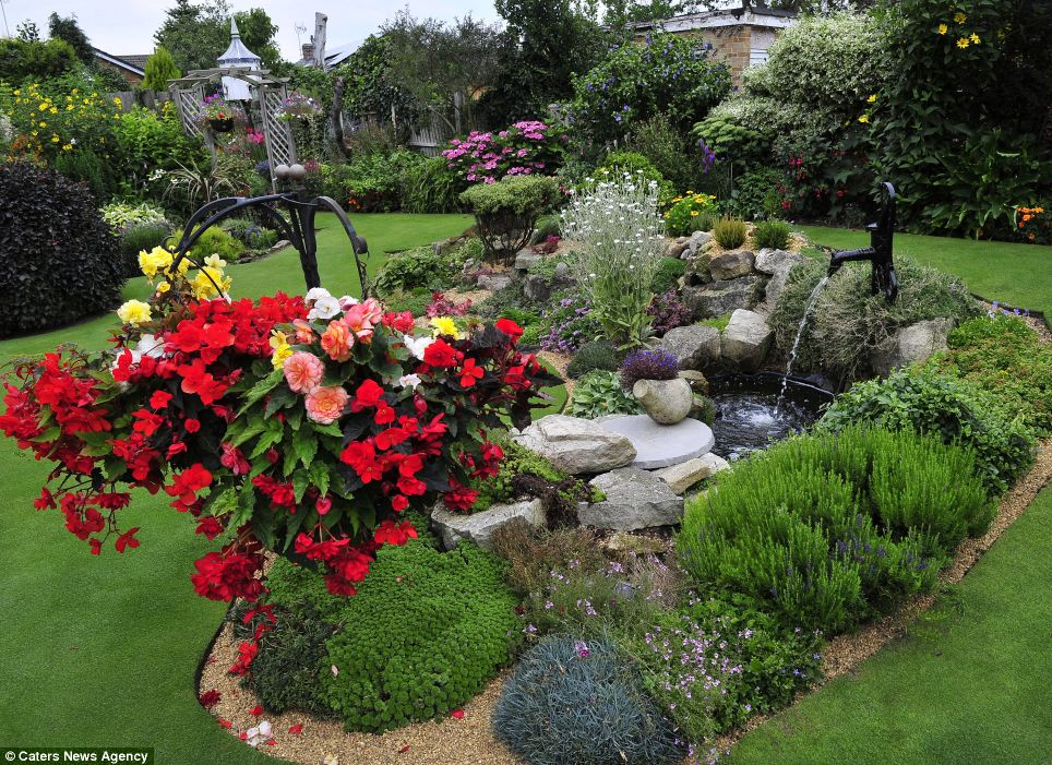 Stunning blooms, neat borders and vibrant shrubs dot the stunning green lawn