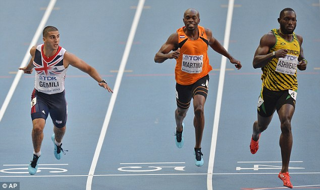 Neck and neck: Gemili dipped to beat Jamaica's Nickel Ashmeade on the line