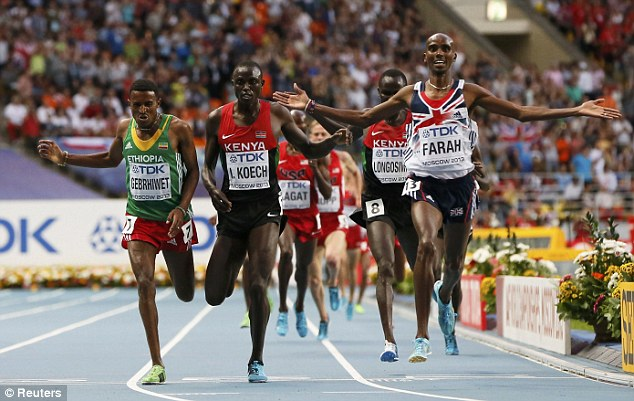 History made: Farah recorded an historic 'double double' holding both 5,000m and 10,000m Olympic and world titles