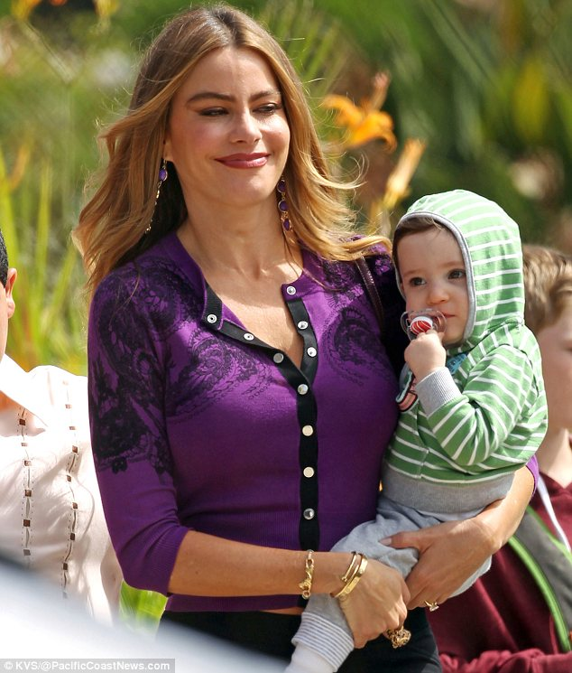 Baby love: Sofia Vergara was seen with a child portraying her character Gloria's son Fulgencio Joseph on set of Modern Family in Los Angeles on Thursday