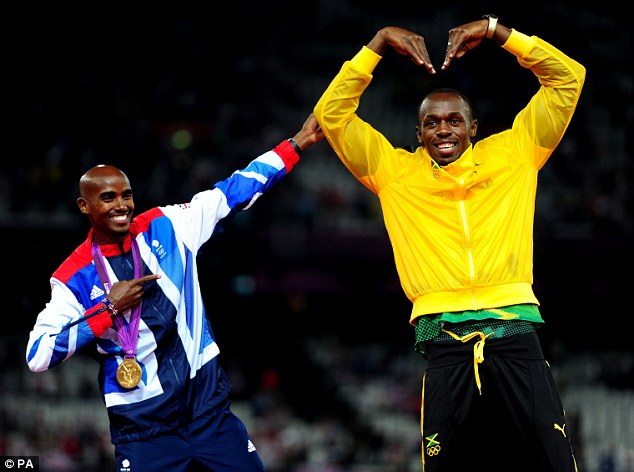Sporting greats: Mo Farah (left) doing Usain Bolt's signature victory pose as Bolt mimics Farah's 'Mobot' on day 15 of the London 2012 Olympics