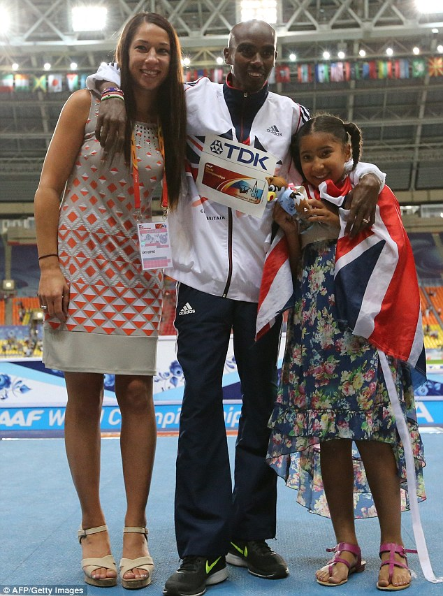 Support: Mo Farah with his daughter Rhianna and wife Tania on the podium during the medal ceremony for the men's 5000 metres