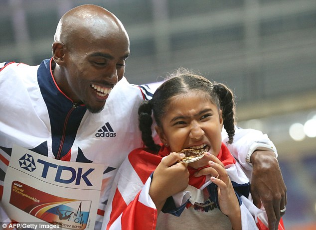 Family affair: Gold medalist Mo Farah poses with his daughter Rhianna on the podium during the medal ceremony