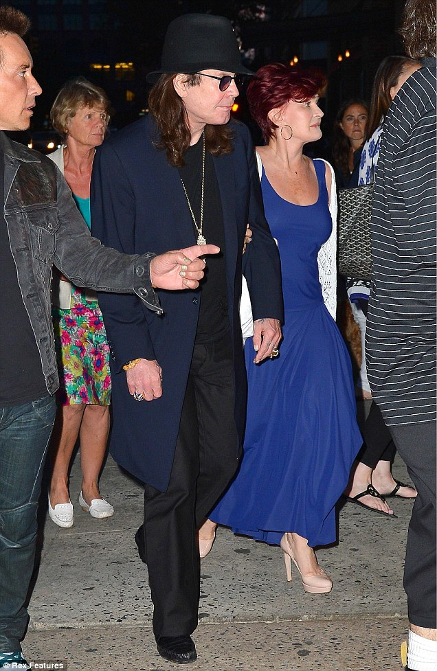 This way: One of their entourage show which way Ozzy and Sharon should go after their meal