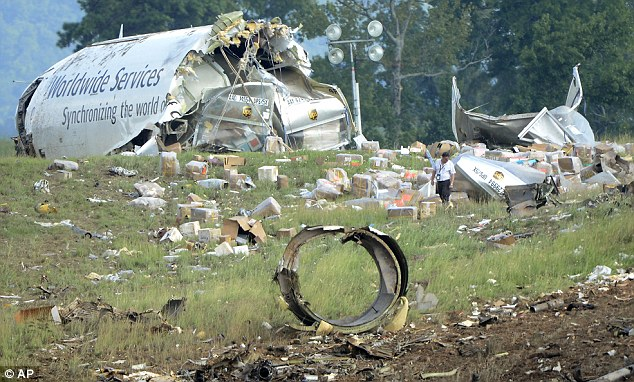 Crash site: Federal investigators say the pilots of a UPS cargo plane that crashed in Alabama on Wednesday were warned their descent was too steep, but that air-traffic controllers didn't receive a similar warning