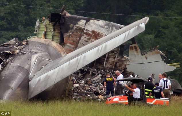 Black box found: NTSB investigators work around the tail section of the UPS cargo plane