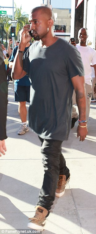 Empty-handed: Kanye left Cartier without any gift-boxes for Kim