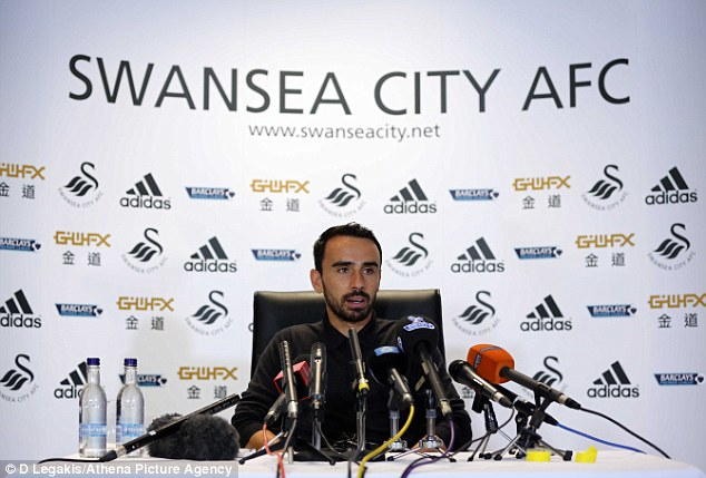 Under the spotlight: Leon Britton talks to the press ahead of Swansea's clash with Manchester United