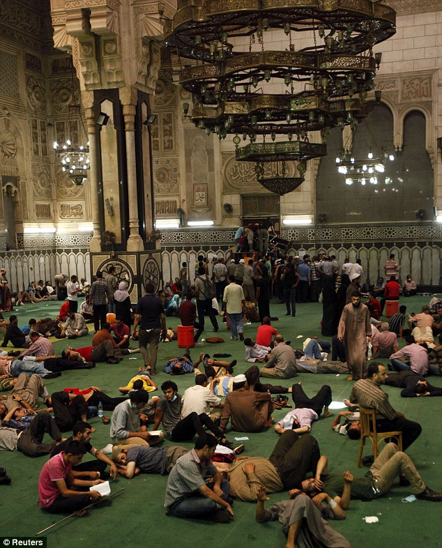 Waiting: Protesters supporting ousted Egyptian President Mohamed Morsi wait inside al-Fath mosque, at Ramses Square in Cairo