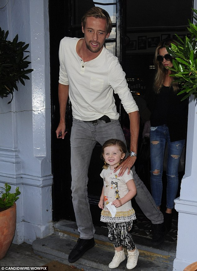 Super tall: Peter showed just how tall he was as he stood beside his daughter when they left the restaurant