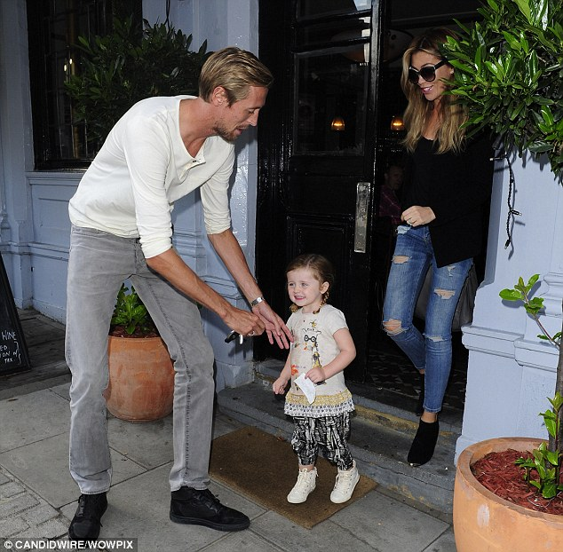 Daddy dearest: Sophia looked delighted as she moved towards her father to be picked up following lunch