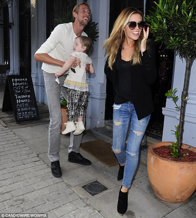 Family fun: Abbey and Peter Crouch looked in high spirits as they had lunch with Sophia on Friday