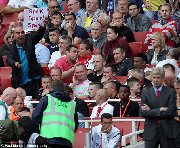 Splash the cash: An Arsenal fan sends a clear message to Wenger