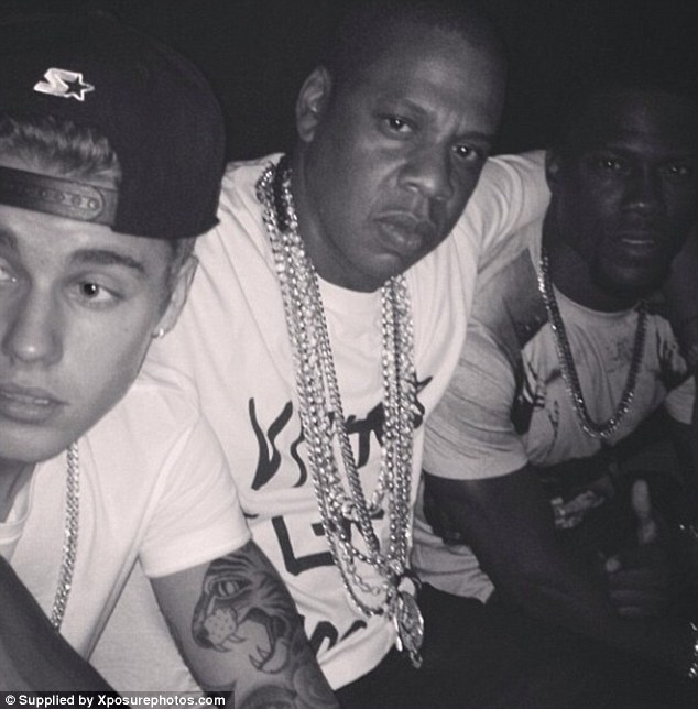 The crew: Jay Z wrapped his arm affectionately around comedian Kevin Hart's shoulder as Bieber cozied up on the other side
