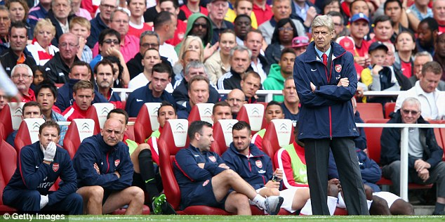 He doesn't look it: Wenger was positive afterwards but wasn't amused when watching on