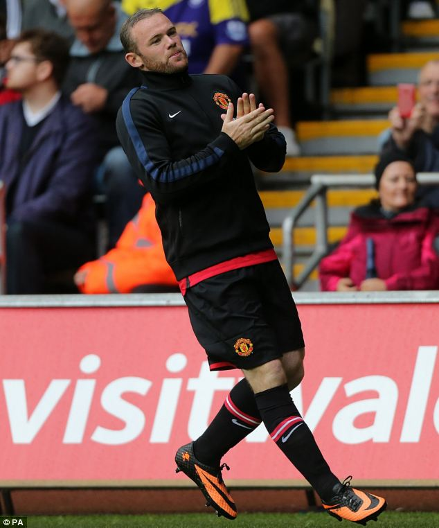 Popular: Rooney received a good reception from the travelling United fans