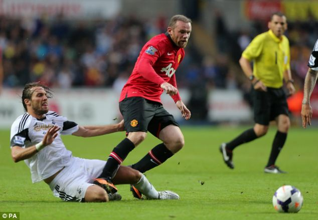 He's back: Rooney came off the bench to set up two goals against Michael Laudrup's side