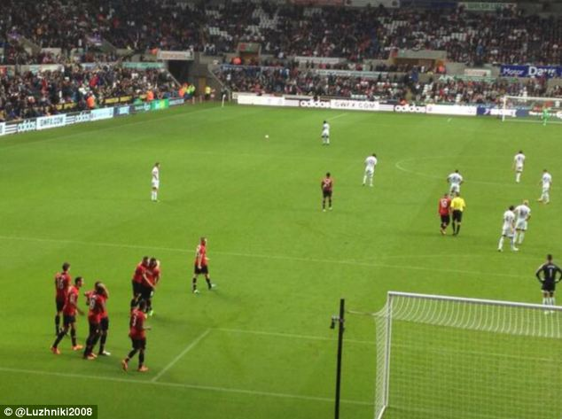 Rooney chats with referee Phil Dowd instead of celebrating with his team-mates