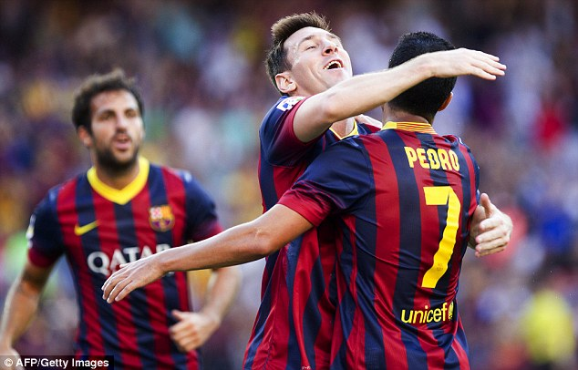 Familiar sight: Lionel Messi notches his first goal of the season after just 12 minutes