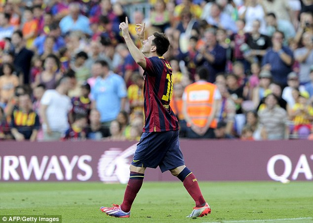 At the double: Messi celebrates his second, scored from the penalty spot