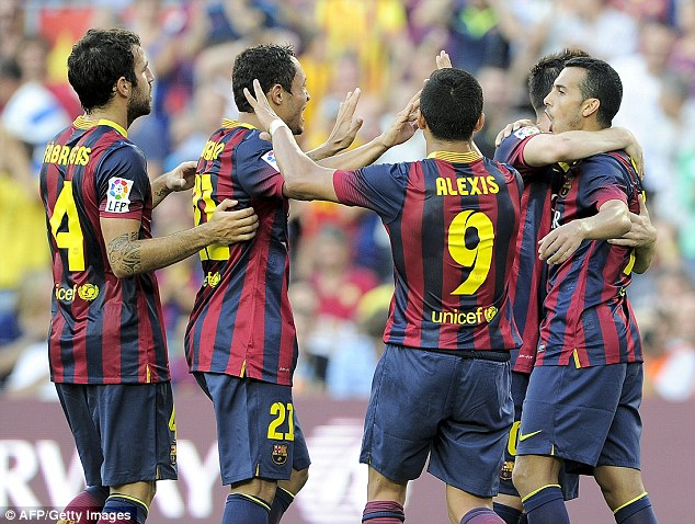 On target: Pedro is congratulated after scoring his team's fourth goal after 26 minutes