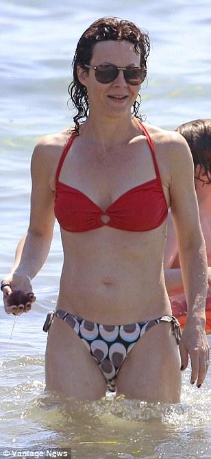 Beach babe: Helen McCrory looked stunning on the beach despite wearing a miss-matching bikini combination