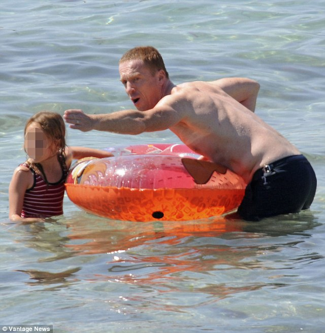 Daddy direction: Damian was giving instructions to his daughter whilst playing in the sea together