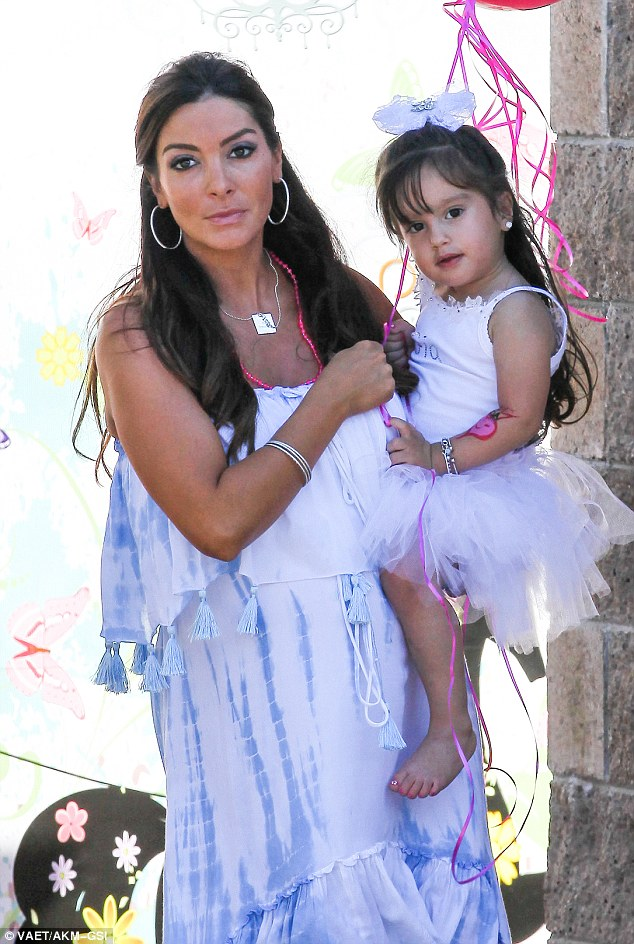 Two of a kind: Courtney and her lookalike daughter both donned pretty white outfits for the celebration, though the soon-to-be mom-of-two opted for a flowy tie-dye dress instead of a tutu