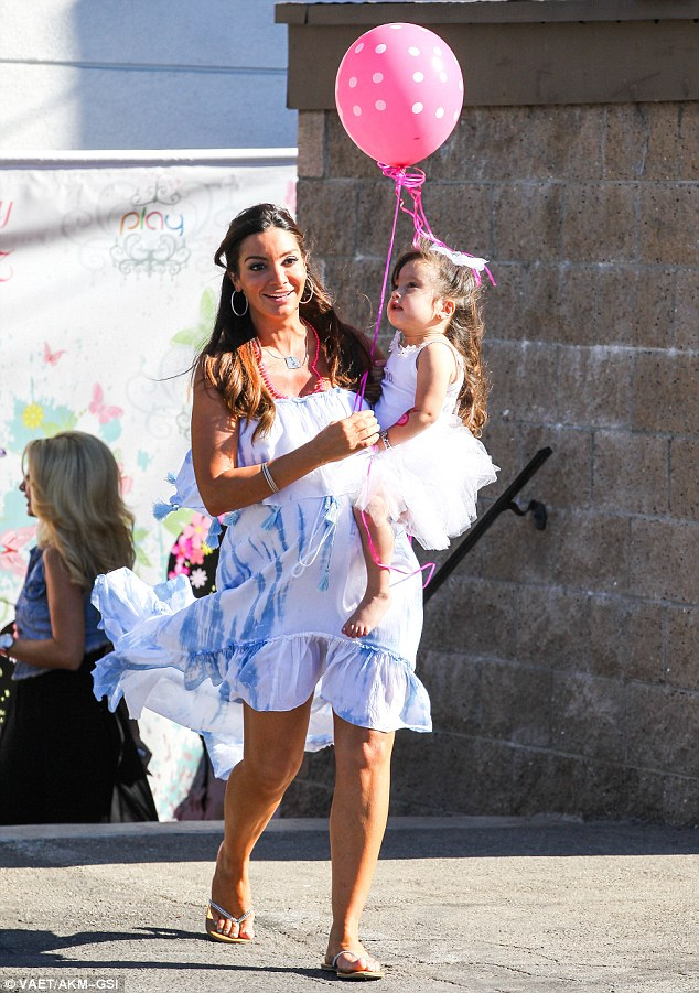 Up, up and away! Little Gia couldn't take her eyes off a big pink and white-spotted balloon her mom was holding as she toted the birthday girl on her hip at the bash in Glendale