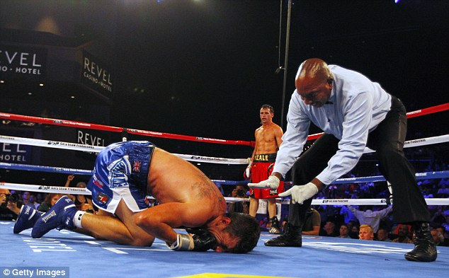 Down but not out: Barker was called for a standing eight count after being knocked down in the sixth
