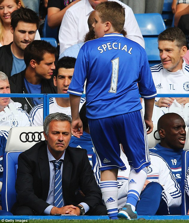 Unimpressed? Or is the sun in Mourinho's eyes?