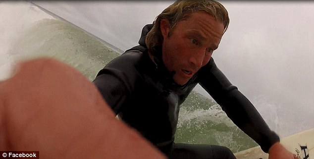 Wipe-out: Greiner's Facebook was still public as of Sunday morning, with several shots of him surfing. A few images on his profile show him teaching young kids how to surf