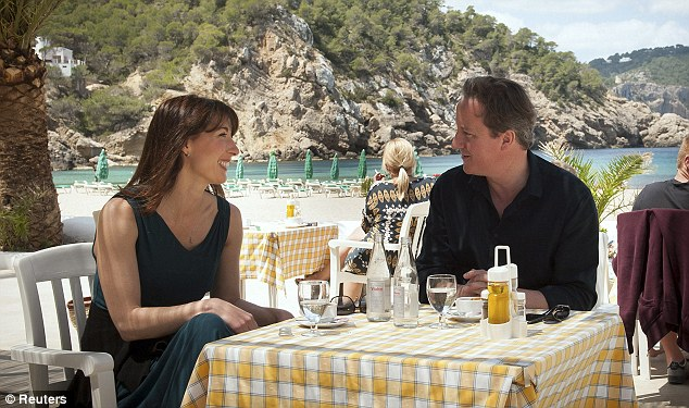 First break: David Cameron and his wife take a drink by a beach during their holiday on the Spanish Balearic island of Ibiza, Spain in May