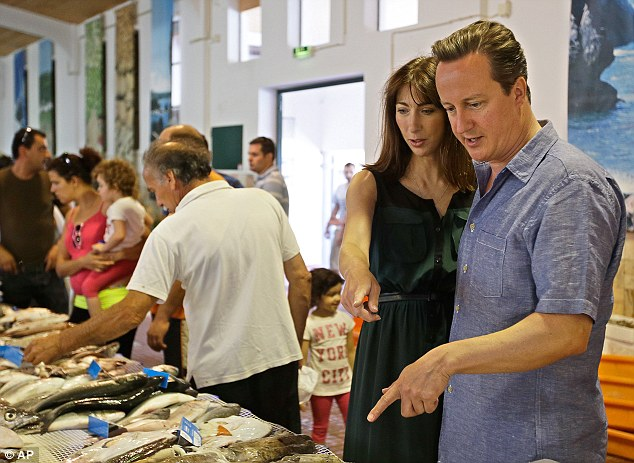 Number two: The Prime Minister and his wife Samantha are pictured at a market in Aljezur, on the southwestern coast of Portugal, in June