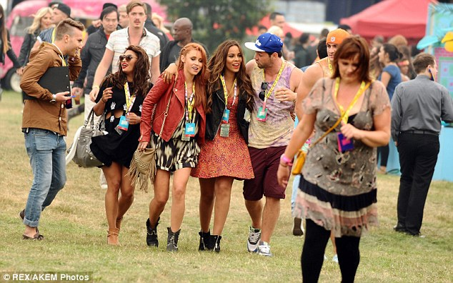 Reunited: After the set the girls headed out to enjoy the festival with the boys in tow