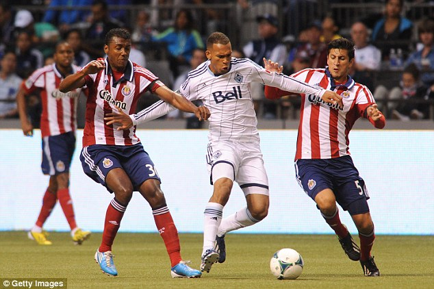 Checks: Chivas USA play against Vancouver, above. One of the men in the lawsuit claims he was asked to look up the ethnicity of players and staff