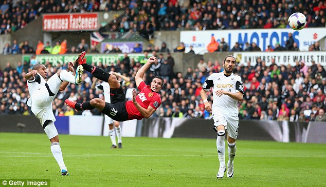 Stunner: His opening goal against Swansea was an acrobatic shot ahead of Ashley Williams