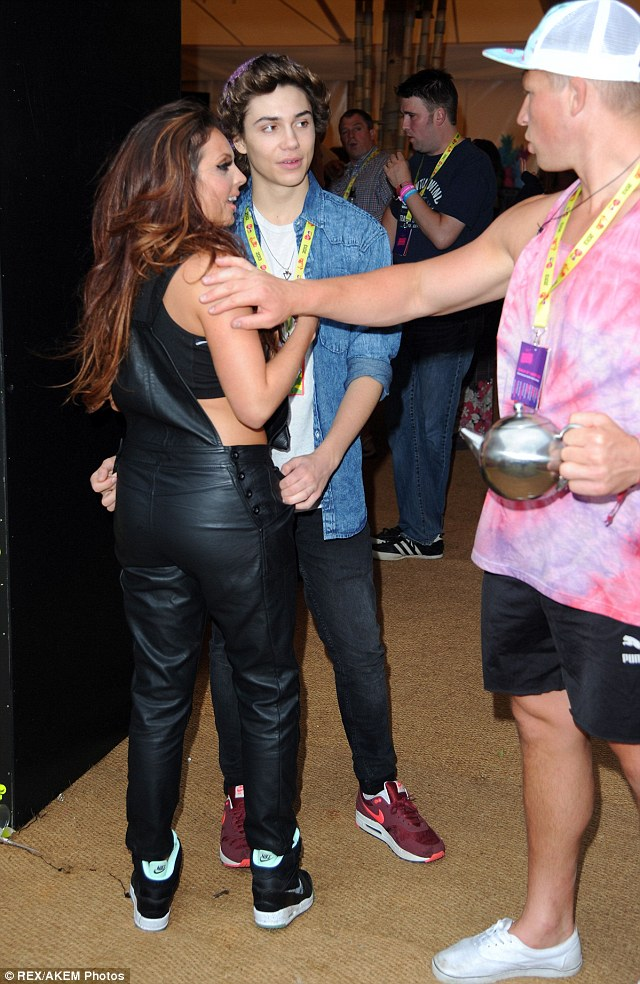 Up close and personal: Jesy Nelson and George Shelley were spotted with their arms around each other in the Virgin Media Louder Lounge at V Festival, in Chelmsford, but their moment was interrupted by a boy holding a teapot