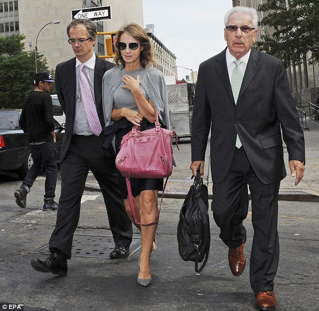 Chic: Former New York University professor, Dutch economist, Heleen Mees, center, exits criminal court with her attorney Ira London, right, and an unidentified man, in New York on Monday August 19