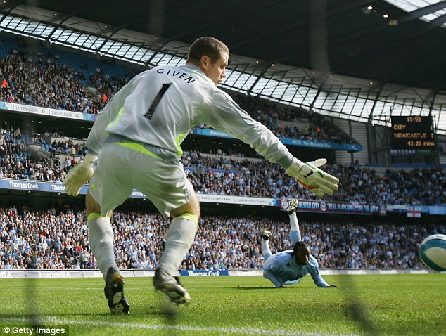 Stoop to conquer: City's Emile Mpenza scores with a header in the 3-1 Etihad win in September 2007