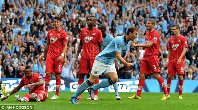Off to a good start: Edin Dzeko scores City's second against Southampton on the opening day last season