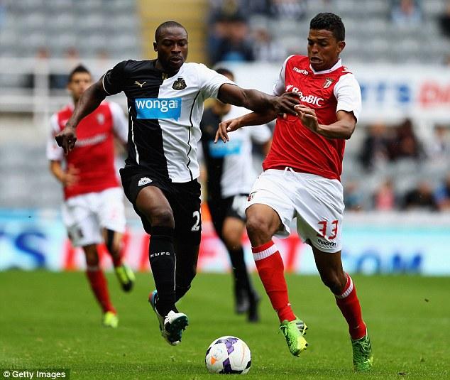 Physical: Shola Ameobi fights with Braga's Aderlan Santos during the pre-season match at St James' Park