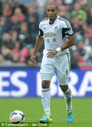 Top four push: Wenger is also attempting to bring in Swansea pair Michu (left) and Ashley Williams (right)