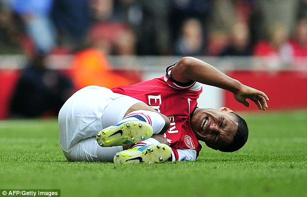Out: Oxlade-Chamberlain could miss the rest of the year with a knee injury
