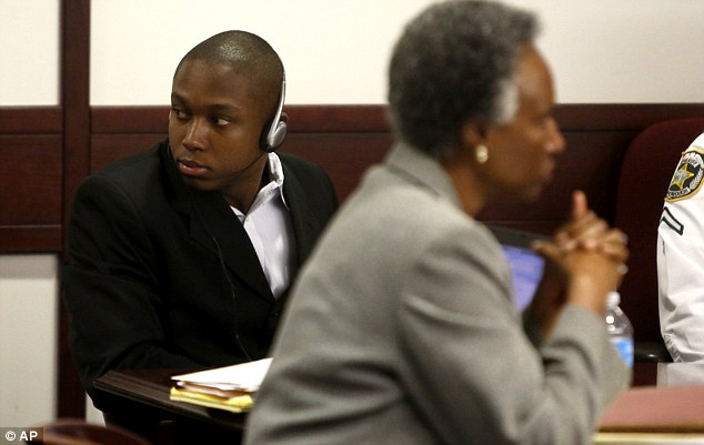 Richard McTear (left) listens to attorneys talk with the judge in court today in Florida