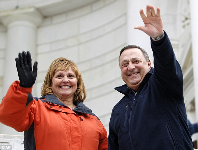 LePage and his wife Ann wave to a crowd during the laying of wreaths at Arlington National Cemetery in December 2012