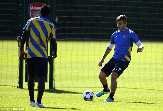 Playmaker: The burden falls more and more on Wilshere with others injured